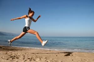Woman Skipping On Beach